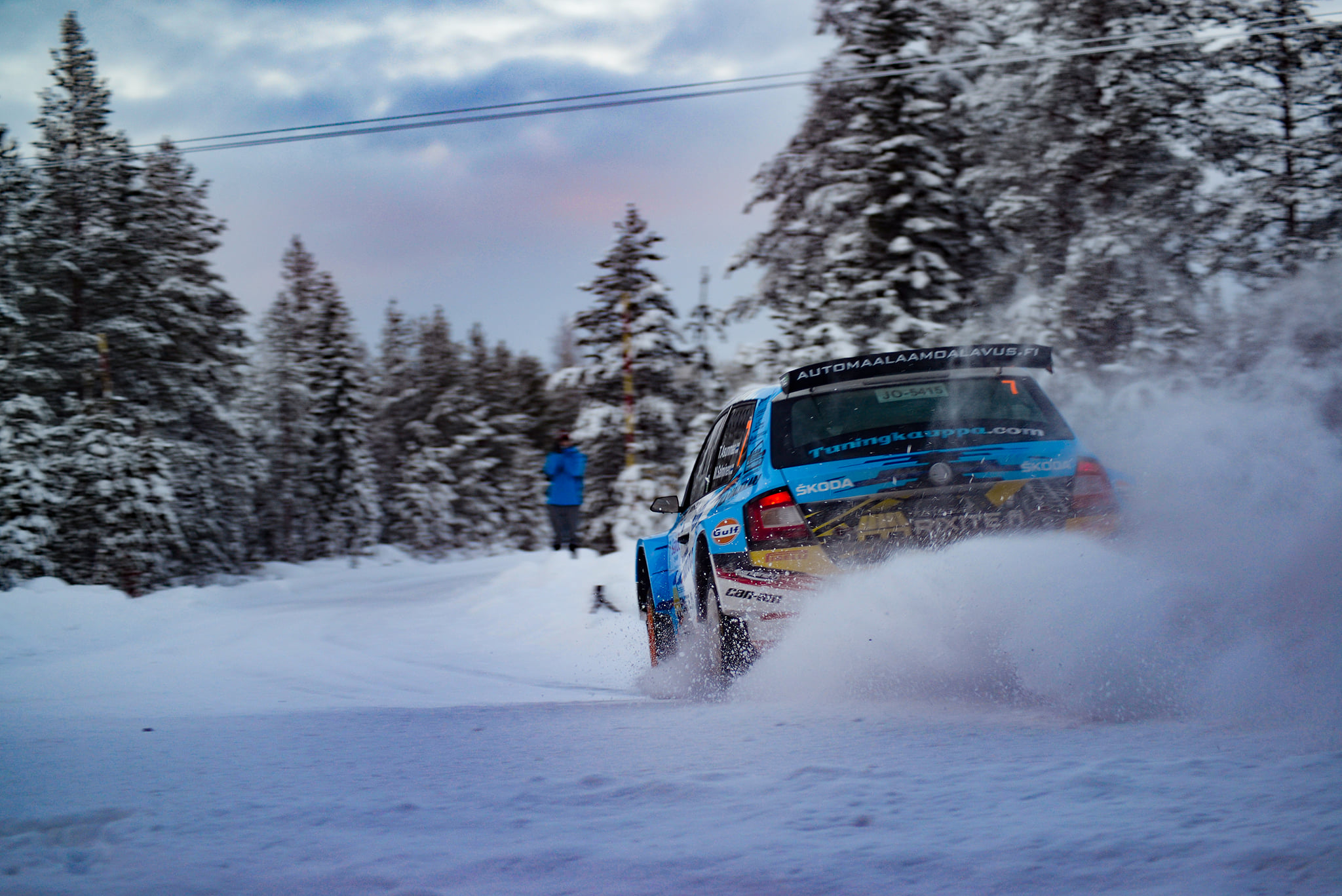 Blue Rally car in the Arctic Circle in Finland
