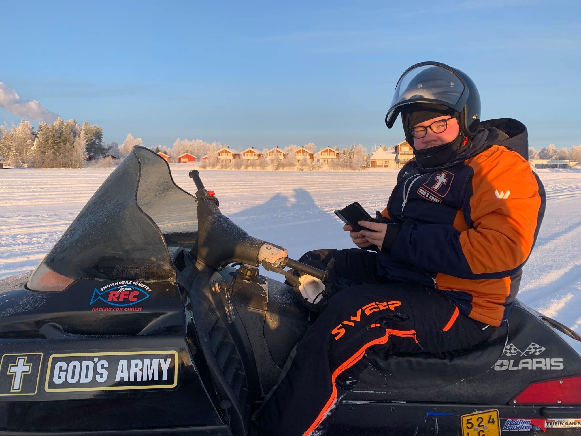 Field staff Johann Sebastian rides a snow mobile as he seeks to serve others.