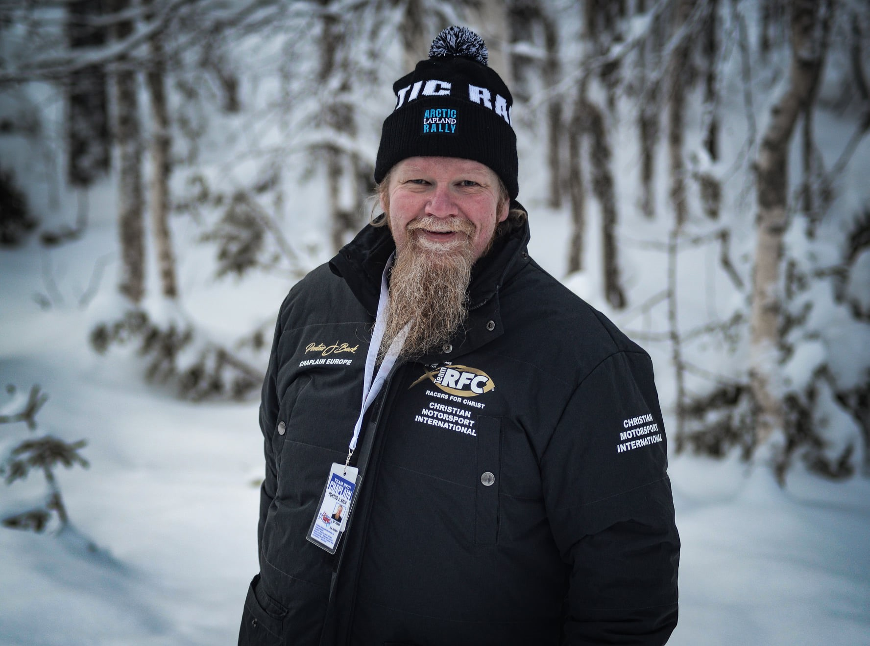 Chaplain Pontus smiling as he serves at a snow event.